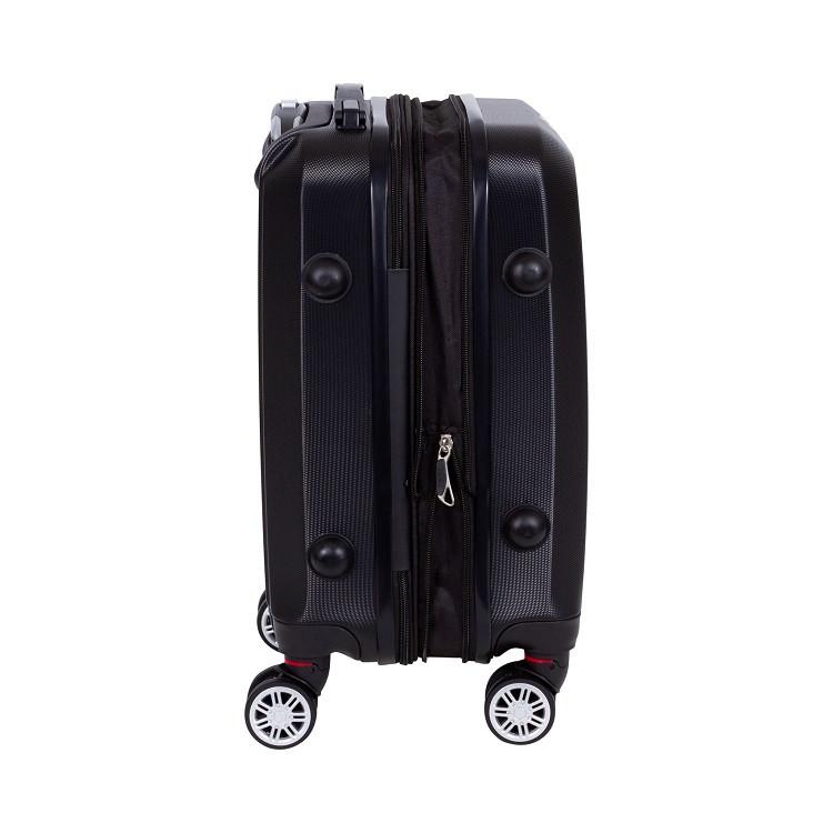 mala-travelux-st-moritz-tamanho-m-preta-detalhe-expansor-e-pés-de-apoio